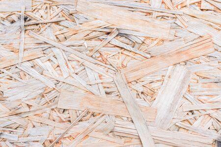 Wood chipboard background. Top view of OSB wood veneer background.