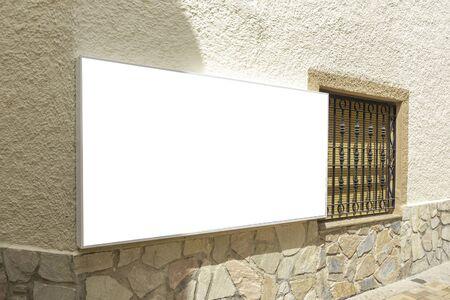 Mock up. Empty rectangular shape signboard on old building wall Фото со стока