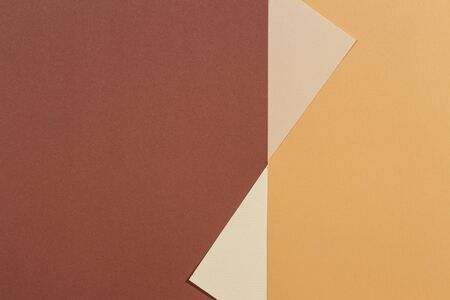 Abstract geometric paper texture background. Beige, brown yellow pastel trendy colors Фото со стока
