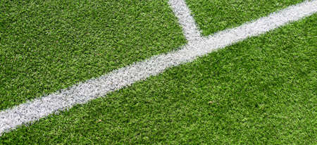 Green artificial grass turf soccer football field background with white lines. Top view Stock Photo