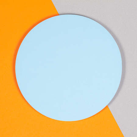 Abstract geometric texture background of soft light blue, pastel gray and orange color paper. Top view, flat lay Foto de archivo