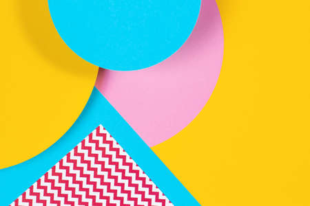 Abstract geometric fashion papers texture background in yellow, light pink, blue colors. Top view, flat lay 写真素材