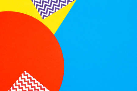 Abstract geometric fashion papers texture background in yellow,red, blue colors. Top view, flat lay Stockfoto