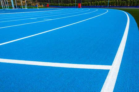 New blue running track and stadium background