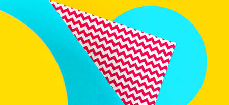 Abstract geometric fashion papers texture background in yellow, red, blue colors and zigzag pattrn. Top view, flat lay