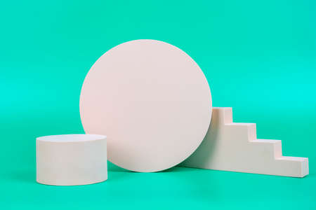 Abstract geometric pastel color product display podium on light green background. Minimal different shapes scene stage showcase stand for product promotion presentation