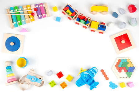 Colorful educational and musical toys for baby kids on white background. Top view, flat lay frame