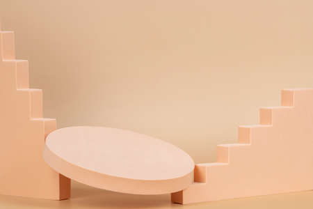 Abstract background trendy composition with geometric shapes form podium, platform on pastel beige background 免版税图像