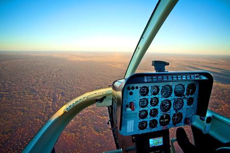 outback australia: Helicopter Cockpit Flying over Desert Outback Australia