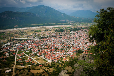 kalambaka: A panoramic view of Kalambaka town in the plain of Thessally - northern Greece. Viewed from the Holy Monastery of Saint Stephen - Meteora Greece. Stock Photo