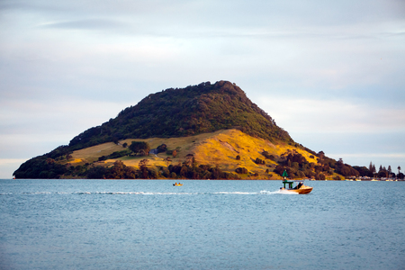mornings: Mount Maunganui in Tauranga New Zealand lit up by the mornings sun rays Stock Photo
