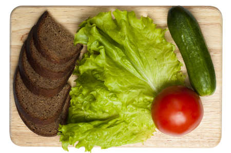 vread and vegetables on the board isolated on white photo