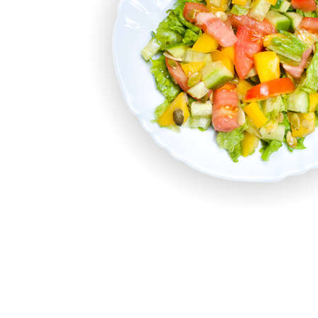 Salad with tomato, pepper, pumpkin seeds on the white  plate photo