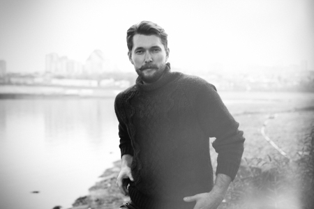 hemingway: Handsome bearded man on the background of the river Stock Photo