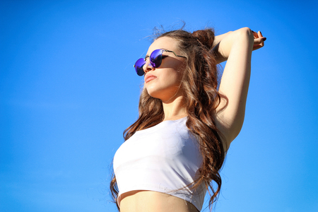 Beautiful Young Woman over blue Sky