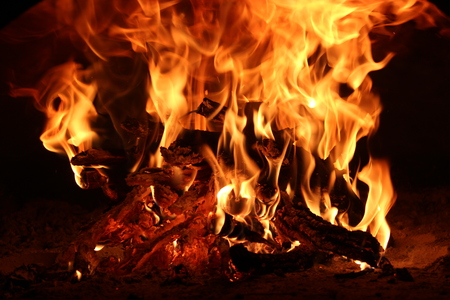 gas fireplace: Camp fire on a dark background. Head Stock Photo