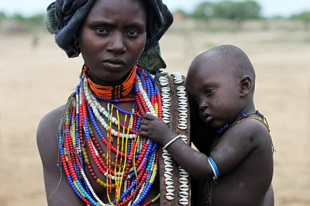 Mother and her son - Ethiopia, Africa - Arbore tribe