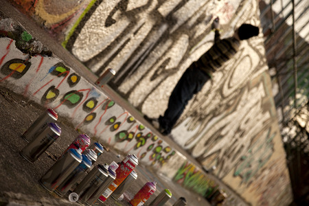 graphity: young graffiti artist sprays picture on the wall - Photo taken 02.05.2014 Editorial