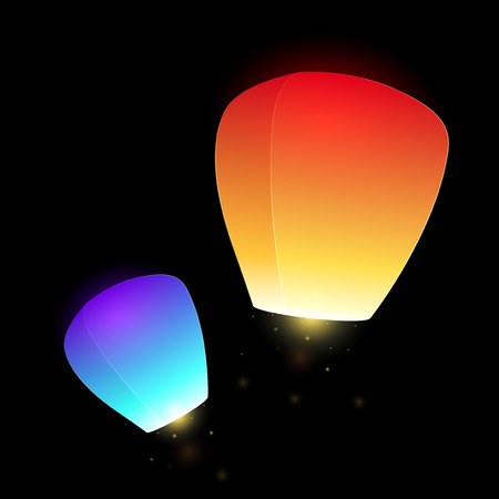 aglow: Set of blue and orange  flying sky lanterns for your creativity