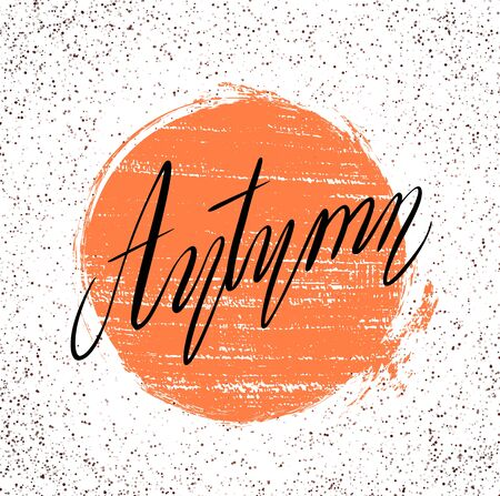 Lettering Autumn written by hand with grunge circle and spotted background. Calligraphic inscription. Vector element