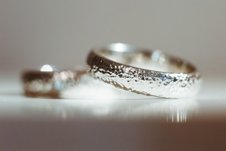 Pre-wedding preparation. Silver wedding rings for weds. Closeup, no people