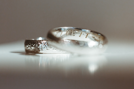 Pre-wedding preparation. Two silver wedding rings for weds. Closeup, no people