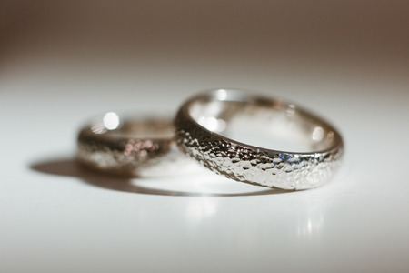 Pre-wedding preparation. Two nice silver wedding rings for weds. Closeup, no people