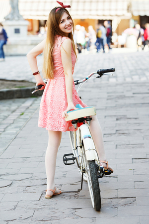 Young girl  with vintage bicycle 写真素材