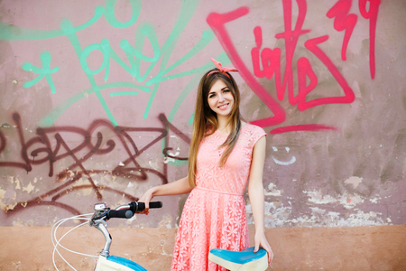 girl with bicycle on graffiti background