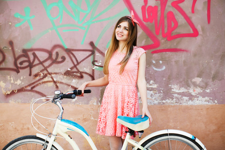 young girl smiling with bicycle