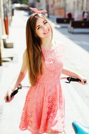 girl holding a bicycle handlebar