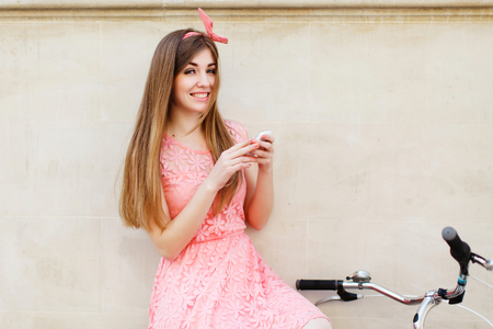 girl smiling and holding smartphone