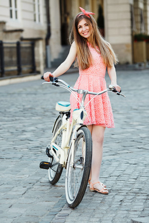 girl with bicycle Standard-Bild