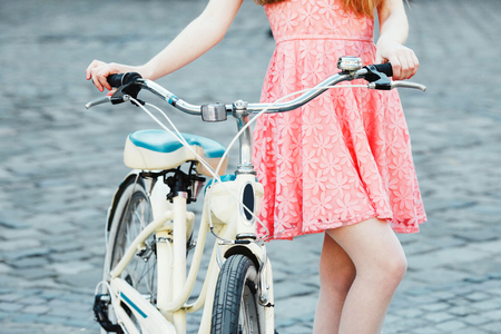 young woman with retro bicycle