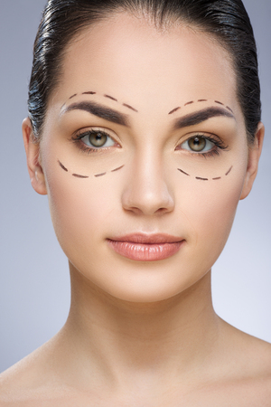 Beauty portrait of model with dashed lines around eyes Imagens