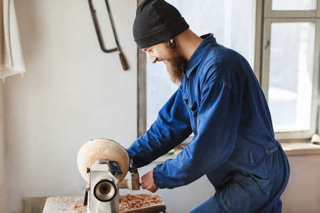 A man working with woodcarving instruments Imagens