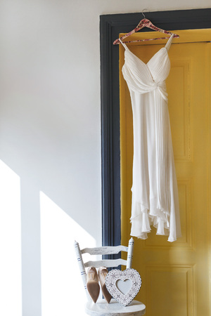White bridal dress hanging on peg Stok Fotoğraf