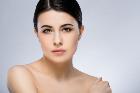 Darkhaired girl with make up at studio