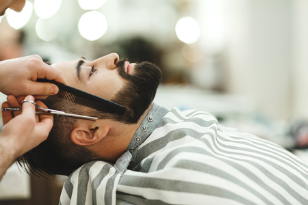 Barber making a beard