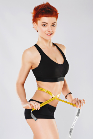 Sportive girl at gray background Imagens