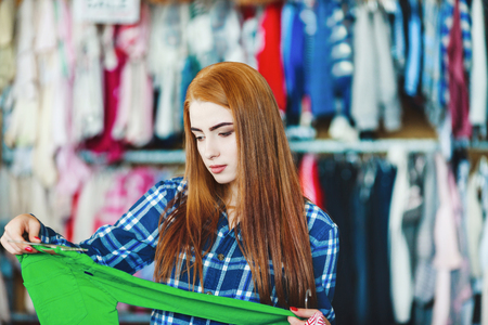 Beautiful girl with long brown hair shopping at store Archivio Fotografico