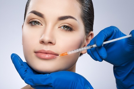 Young lady operated by plastic surgeon