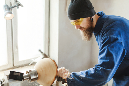 A man working with woodcarving instruments Stock Photo
