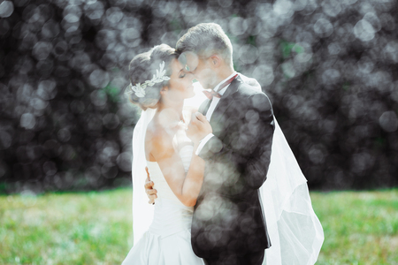 Bridegroom and bride under heavy rain