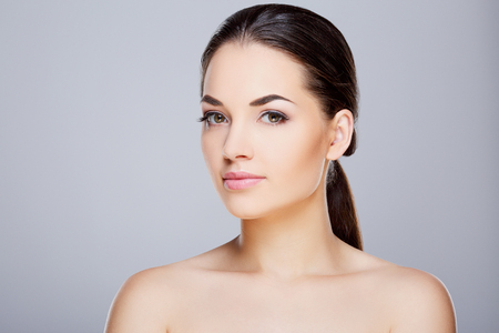 Beauty portrait of young girl with nude make-up
