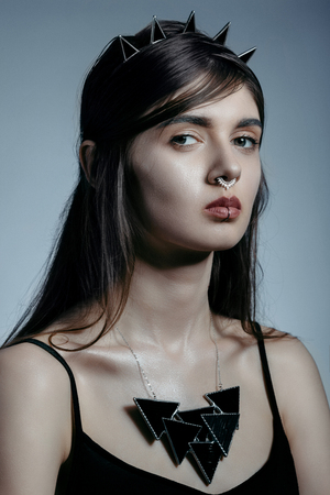 Girl with piercing, black necklace and hoop