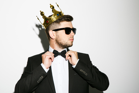 Attractive man in black suit and sunglasses