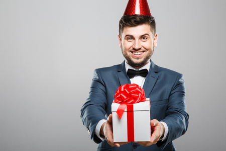 Man holding birthday present