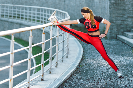 Young girl doing split