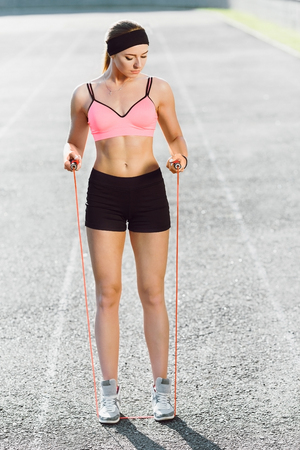 Girl standing on skipping rope